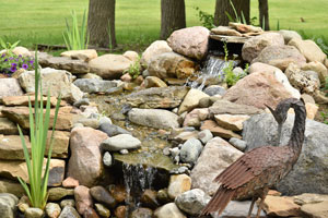 Backyard water feature. D & F Plumbing in Portland OR & Vancouver WA offers tips for adding a backyard water feature.